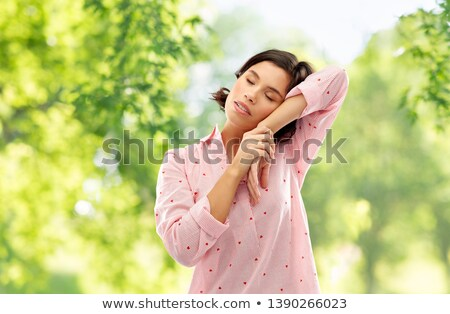 woman in pajama napping over natural background Stock photo © dolgachov