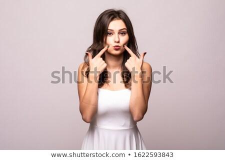 Fotografia zabawny kobieta wskazując palce policzki Zdjęcia stock © deandrobot