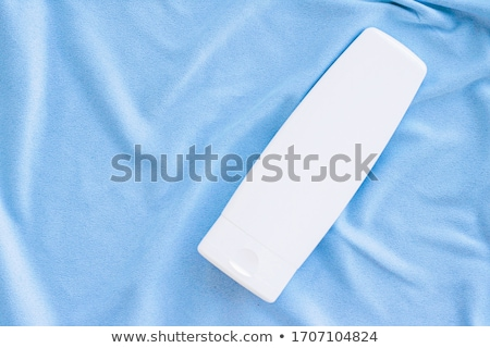 Blank label tube of hand cream or body lotion mockup on silk fabric, beauty product and skin care co Stock photo © Anneleven