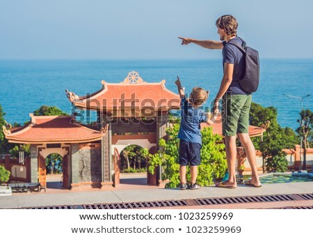 Happy tourists mom, dad and son travel to Vietnam. Travel to Asia concept. Traveling with kids conce Stock photo © galitskaya