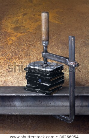 Stock photo: clamp pressing on stack of hard drives
