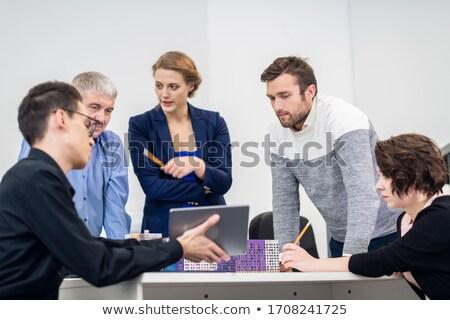 confident boss with secretary planning their work  Stock photo © dacasdo