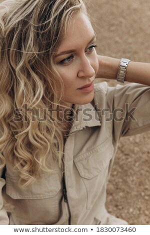 portrait of a beautiful fashionable elegant woman with remote co stock photo © hasloo