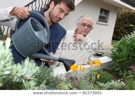 young man watering plants with older woman Stock photo © photography33