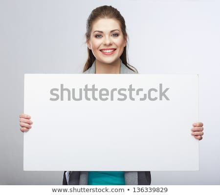 Beautiful young girl smiling holding blank card Stock photo © posterize