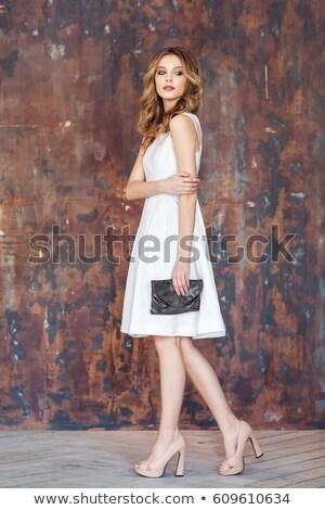 Piękna młoda dziewczyna biały suknia czarny kobieta Zdjęcia stock © RuslanOmega