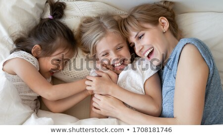 A family cuddling in bed together Stock photo © photography33
