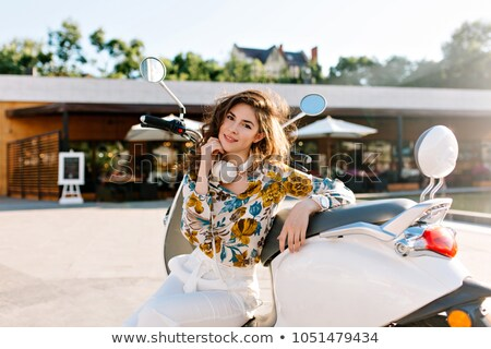 young woman on a moped in town stock photo © photography33