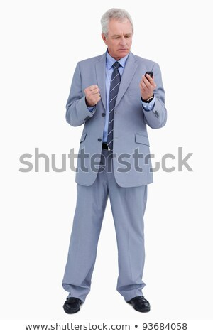 Mature tradesman giving his cellphone an angry look against a white background
