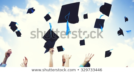 Graduation hats thrown in the air Stock photo © Lightsource
