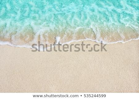 beach sand waves warm texture background stock photo © lunamarina