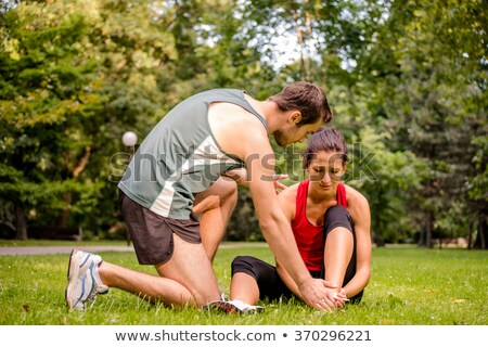 fitness woman exercising holding her ankles Stock photo © Rob_Stark