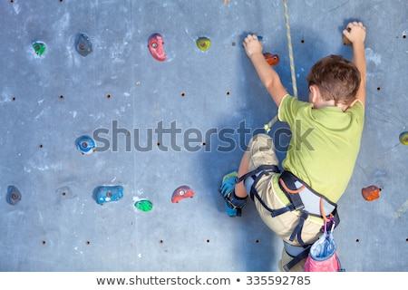 climbing a wall in park Stock photo © art9858
