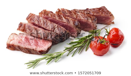 Delicious juicy hot roast beef cut into delicious pieces of meat and vegetables. Served on a black s Stock photo © mcherevan
