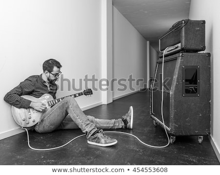 playing his electric guitar in the hallway stock photo © sumners