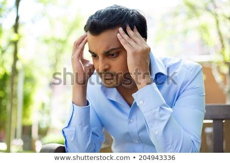 Közelkép portré hangsúlyos fiatal ázsiai férfi Stock fotó © cozyta