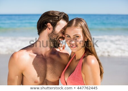 gömleksiz · genç · cep · telefonu · plaj · gökyüzü - stok fotoğraf © wavebreak_media