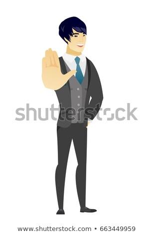 Asian groom showing palm hand. Stock photo © RAStudio