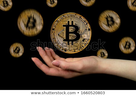 Bitcoin mão branco isolado negócio dinheiro Foto stock © OleksandrO