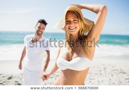 улыбаясь пару пляж человека женщину улыбка другой Сток-фото © iofoto