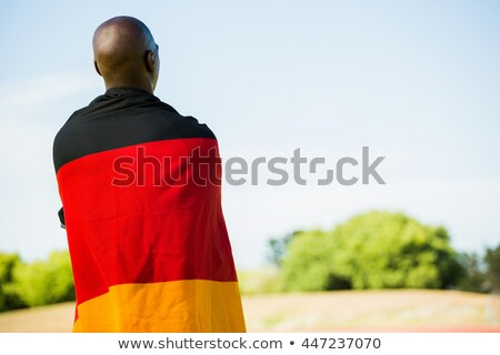 Athlete with german flag wrapped around his body Stock photo © wavebreak_media