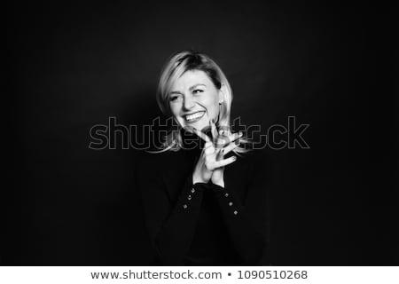 Pretty blond lady on the black-white background Stock photo © konradbak