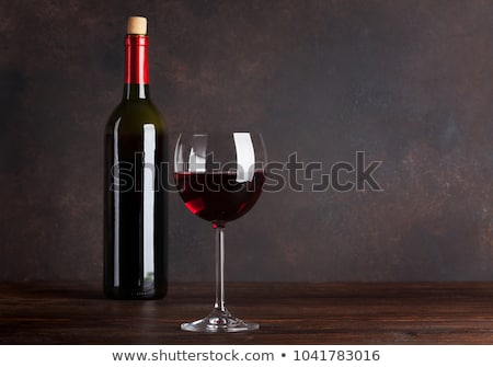 Glass of red wine on wooden board on black background. Space for text Stock photo © DenisMArt
