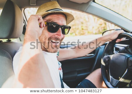 Men sitting in a rental car on holiday vacancy with sunglasses Stock photo © Lopolo
