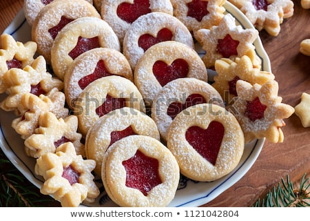 Filling traditional Linzer Christmas cookies with strawberry jam Stock photo © madeleine_steinbach
