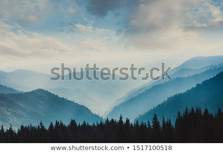 landscape layers mountains in haze stock photo © juhku