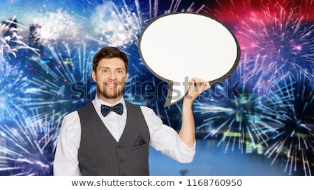 man in suit with blank text bubble over firework Stock photo © dolgachov