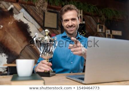 Gelukkig man wijzend vinger trofee Stockfoto © feedough