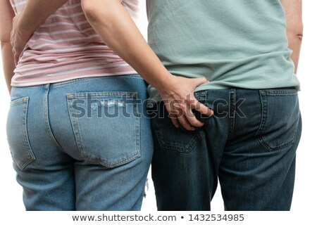 Man Touching Woman's Ass From Back Stock photo © AndreyPopov