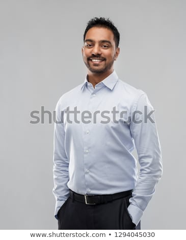happy indian businessman in shirt over grey Stock photo © dolgachov