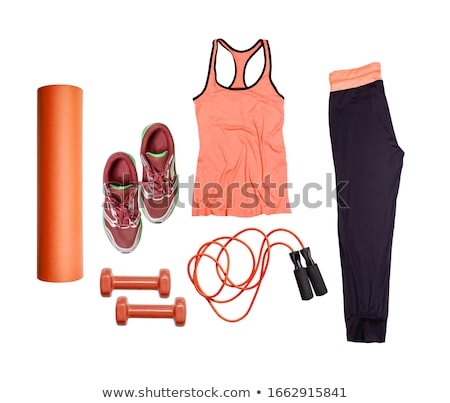 Overhead view woman's workout outfit. Female sports equipment. Purple running shoes, water bottle an Stock photo © Illia