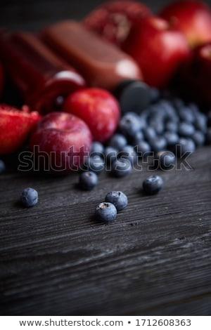 Keverék friss piros fekete gyümölcsök fa asztal Stock fotó © dash