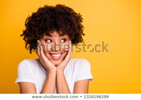 Jóvenes morena mujer sonrisa con dientes pelo rizado Foto stock © pressmaster