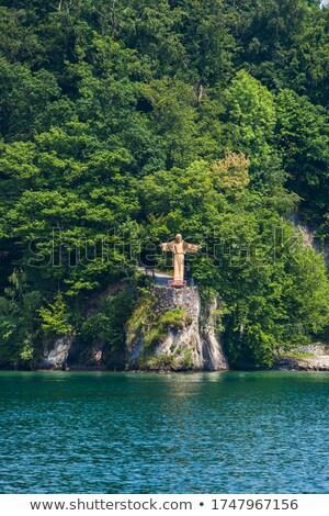 Jézus Krisztus szobor tó Svájc víz Stock fotó © boggy