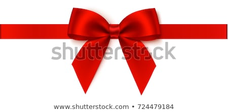 red bow on a red ribbon with white background stock photo © orson