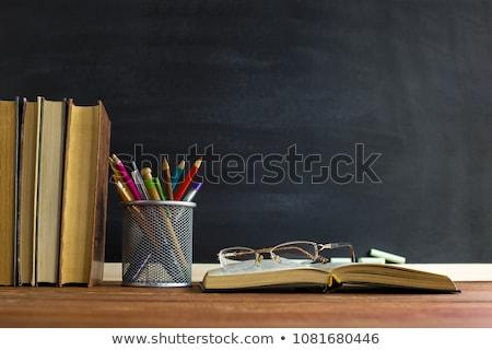 Professor tabela morena menina óculos bibliotecário Foto stock © OleksandrO