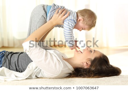 Mother and son smile to each other Stock photo © pekour