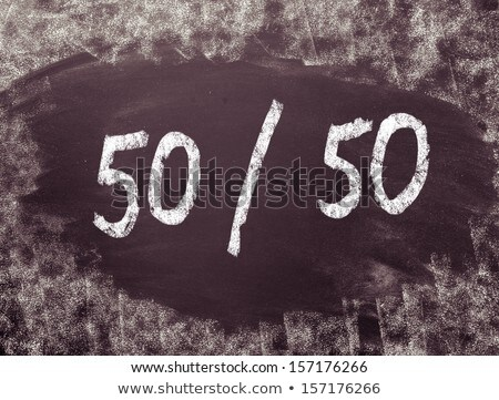 Even fifty-fifty chance written on a blackboard. Stock photo © latent