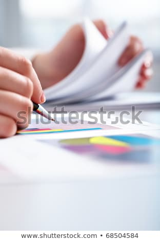human hand with pen and notepaper stock photo © ozaiachin