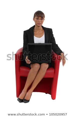Businesswoman sat in designer red leather chair Stock photo © photography33