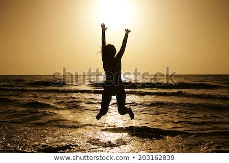 fiatal · vörös · hajú · nő · lány · ugrik · tengerpart · nő - stock fotó © massonforstock