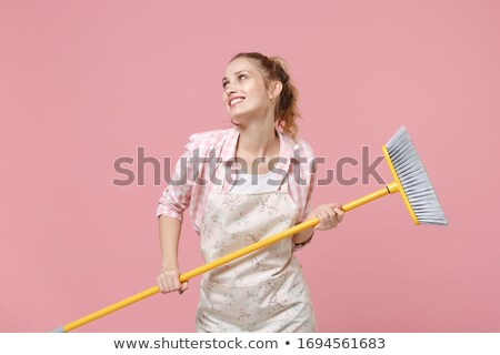 Stok fotoğraf: Smiling Cleaner Woman Holding A Broom In The White Background