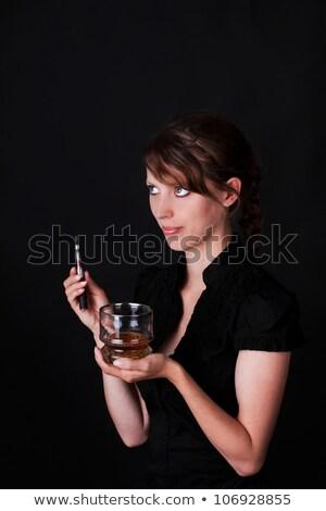 Bere whiskey ragazza occhi tecnologia Foto d'archivio © Pasiphae