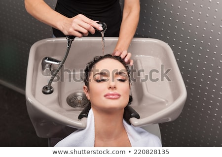 Model having her hair curled by a stylist Stock photo © stryjek