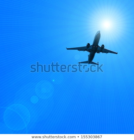 Dark silhouette of an airplane flying over the blue skies Stock photo © lightpoet