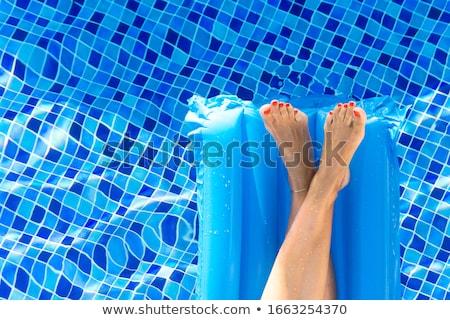 Feet in the Swimming pool Stock photo © gemenacom